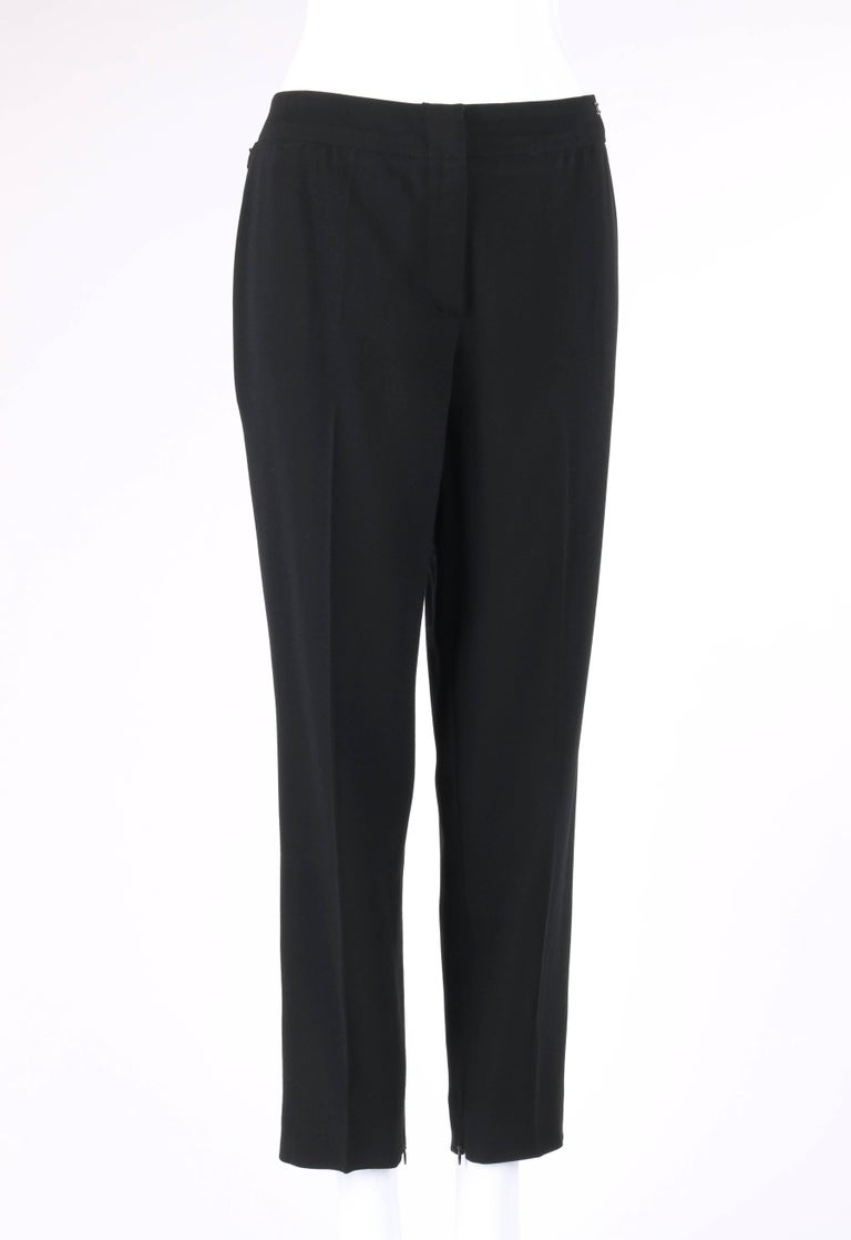 Chanel Spring/Summer 2003 classic black wool slim cut cropped pants / trousers. Designed by Karl Lagerfeld. Thin banded waist. Center front zip fly with two hook and bar closures at top. Two side seam invisible zipper closure pockets at hips. Black