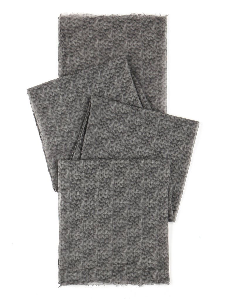 Brunello Cucinelli cashmere two-tone gray over-sized oblong scarf. Two-tone gray smokey patterned cashmere. Raw edge at top and bottom with rolled edge at sides. Semi-sheer. Large oblong shape. Marked Fabric Content: