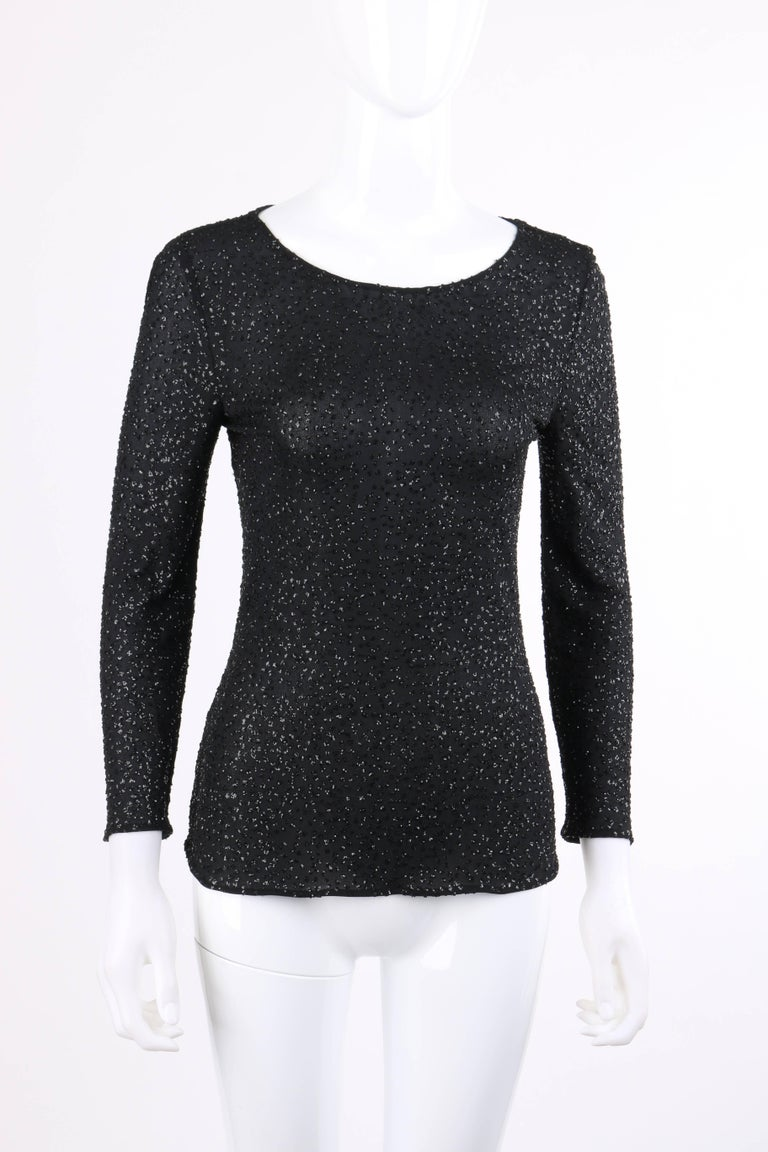 Valentino Boutique Autumn/Winter 2000 black metallic sequin knit scoop neck top designed by Valentino Garavani. Black semi-sheer knit with all over sequin clusters. 3/4 length sleeves. Wide scoop neckline. Center back invisible zipper with hook and