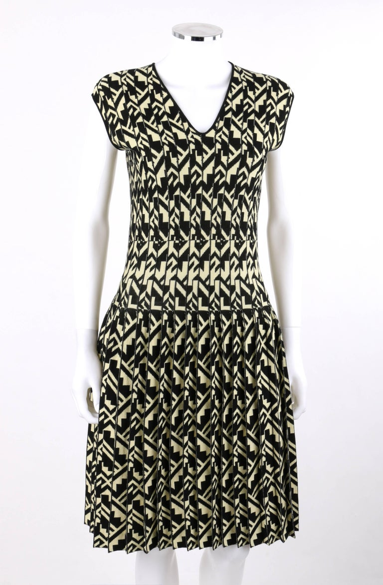 Etro Milano black and soft yellow geometric print knit drop waist pleated cocktail dress; new with tags. V neckline. Sleeveless. Drop waist. Knife pleated skirt. Slip-on style. Thin black rib knit detail at neckline and arm holes. Unlined. MSRP