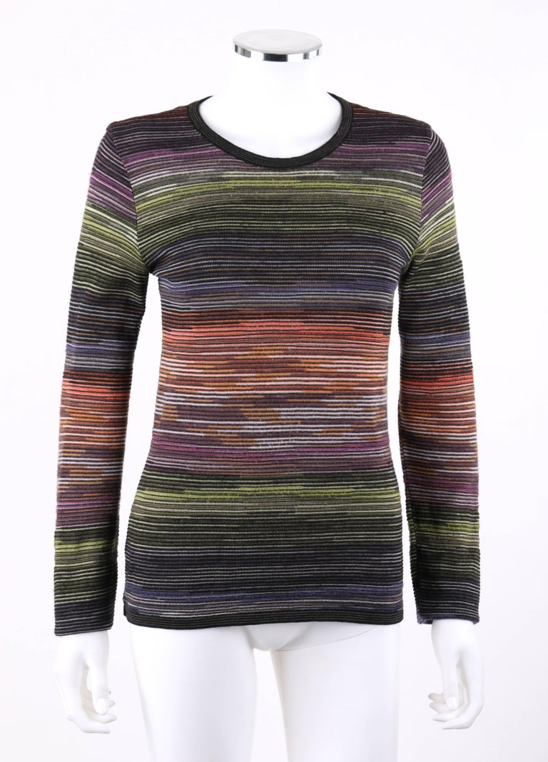 Missoni Sport rainbow striped wool knit long sleeve crew neck top. Crew neckline. Long sleeves. Black and gray striped rib knit detail at neckline, cuffs, and hem. Slip-on style. Unlined. Marked Fabric Content: