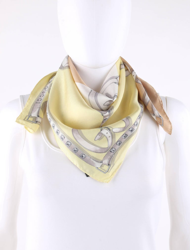 Gucci beige white yellow tri-color monogram belt print silk scarf. Tri-color background in beige, white, and soft yellow. White
