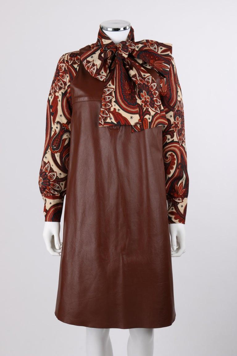DESCRIPTION: ANNE KLEIN c.1970's 3 Piece Paisley Blouse Leather Jumper Dress Set w/ Sash   Circa: c.1970's Label(s): Anne Klein; Saks Fifth Avenue The Anne Klein Corner  Designer: Donna Karan Style: Three piece dress set Color(s): Paisley print in