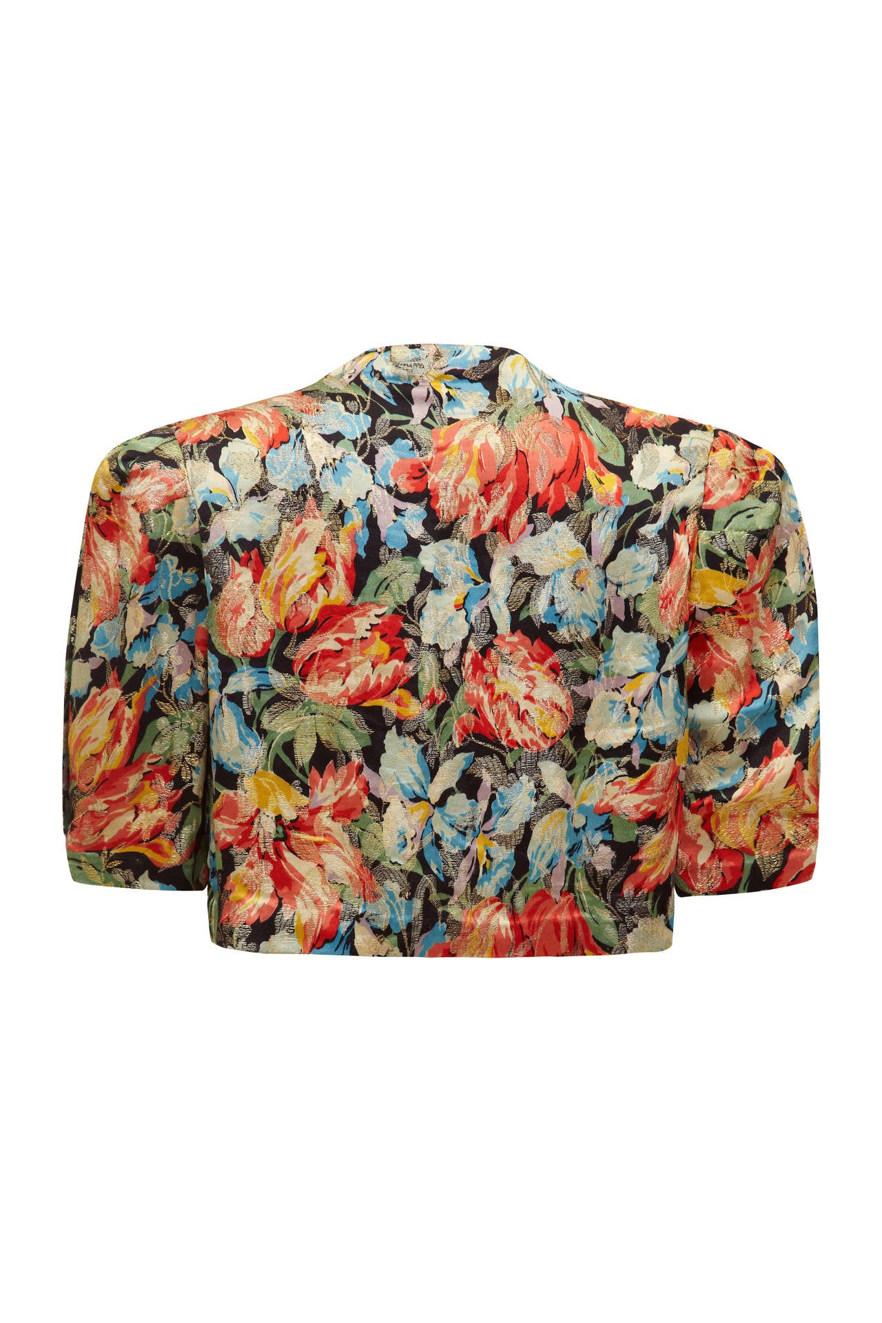 Absolutely stunning 1930s bright floral print jacket/ bolero with beautiful gold lame floral design layered on top. As this piece is worn open with no fastenings there is slight flexibility in size and there is slight padding to the shoulders to