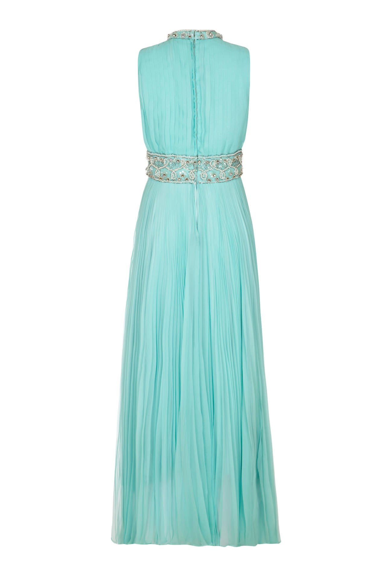 Absolutely amazing full length turquoise pleated chiffon gown from American label Cerdley.  This piece features fabulous beaded and sequined waistband and neckline, is fully lined and fastens at the back with a zip. A beautiful and striking dress in