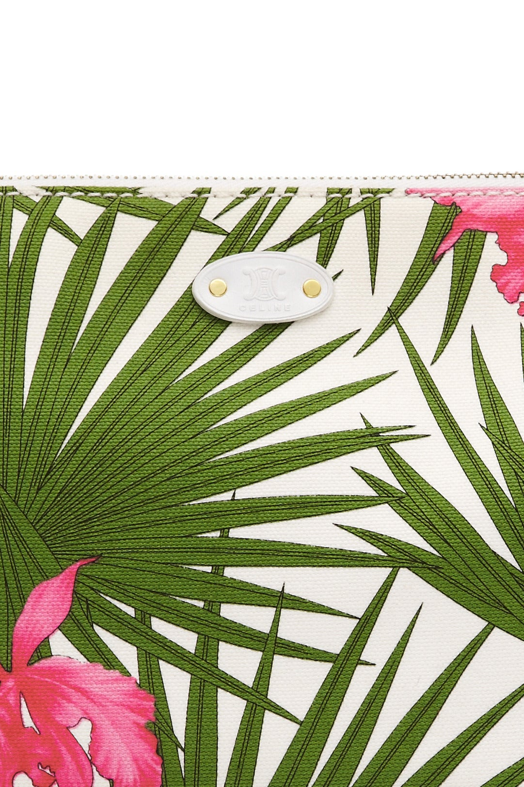 Beautiful 1990s Celine canvas bag with green and pink palm and floral print throughout, white leather trim and gold tone hardware.  This bag in fully lined in complimenting  bright pink canvas with an extra interior pocket.  A great piece in