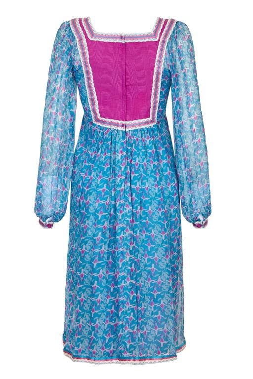 Lovely vintage 1970s blue and pink floral printed silk chiffon dress by London design house Rumak.  This pretty dress features a back and front yoke with lace and ribbon boarders matching the cuffs and hem of the skirt.  Inside the dress is lined in