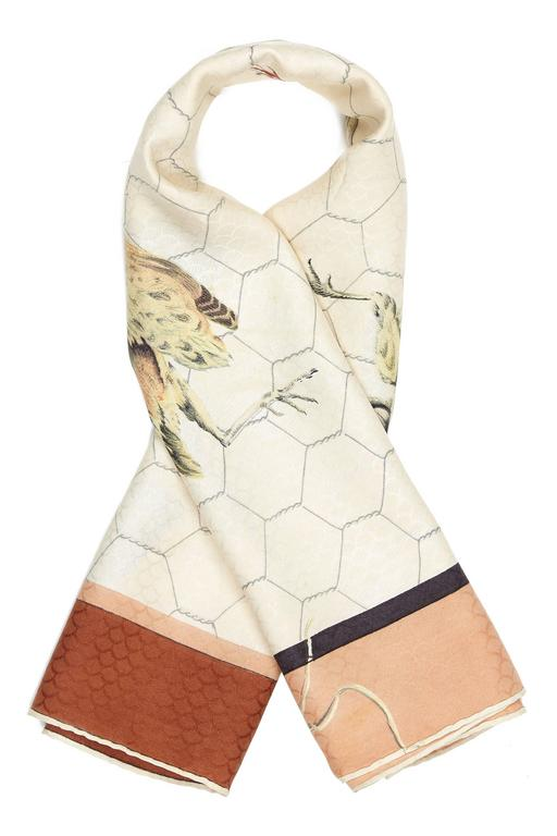 Tableau de Chasse vintage Hermes silk twill scarf designed by Henri de Linares literally translated as 'Hunting Table' and features a bird design in white, terracotta and grey. This scarf was first issued in 1950 and only re issued once in