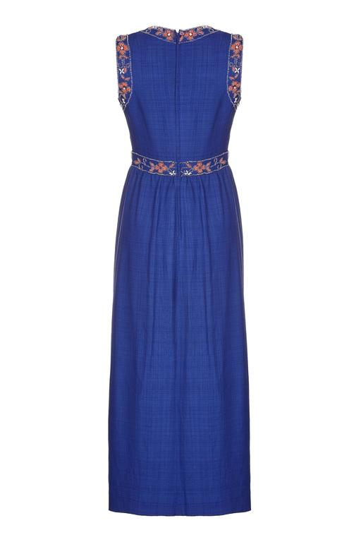 Lovely vintage 1970s Susan Small maxi dress in a blue silk and linen mix. There is lovely floral beading on the bodice with rhinestones and pearls mixed in. It features at fitted waist, is fully lined in matching blue acetate and fastens at the back