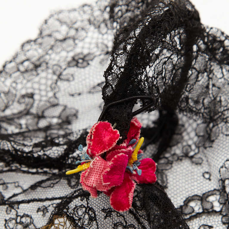 Gorgeous little cap from the 20's made of the most delicate gold lace with black lace trim.  Wire in sides holds the shape of the cute circles at the ears with mini pink velvet flowers. In excellent condition especially considering its age.  Hat