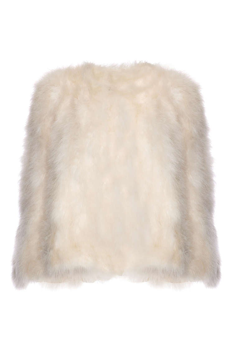 A very elegant and versatile little waist length cape made of ivory marabou feathers. It is shaped to fit and sits beautifully on the shoulders with a single large hook and eye to fasten at the centre front.  As it is then open from the neck down it