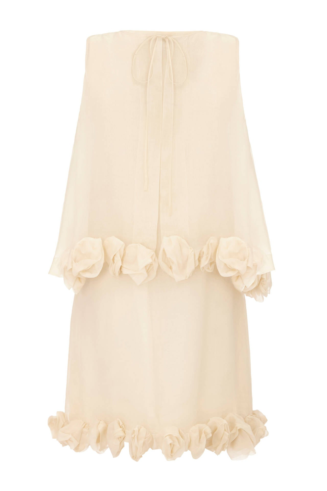 Sensational ivory silk organza dress and sleeveless jacket set with sculptural 3D organza roses around the hems.  This vintage 1960s piece by Christian Dior is couture made and would make a fantastic alternative bridal outfit.  It is in very good to
