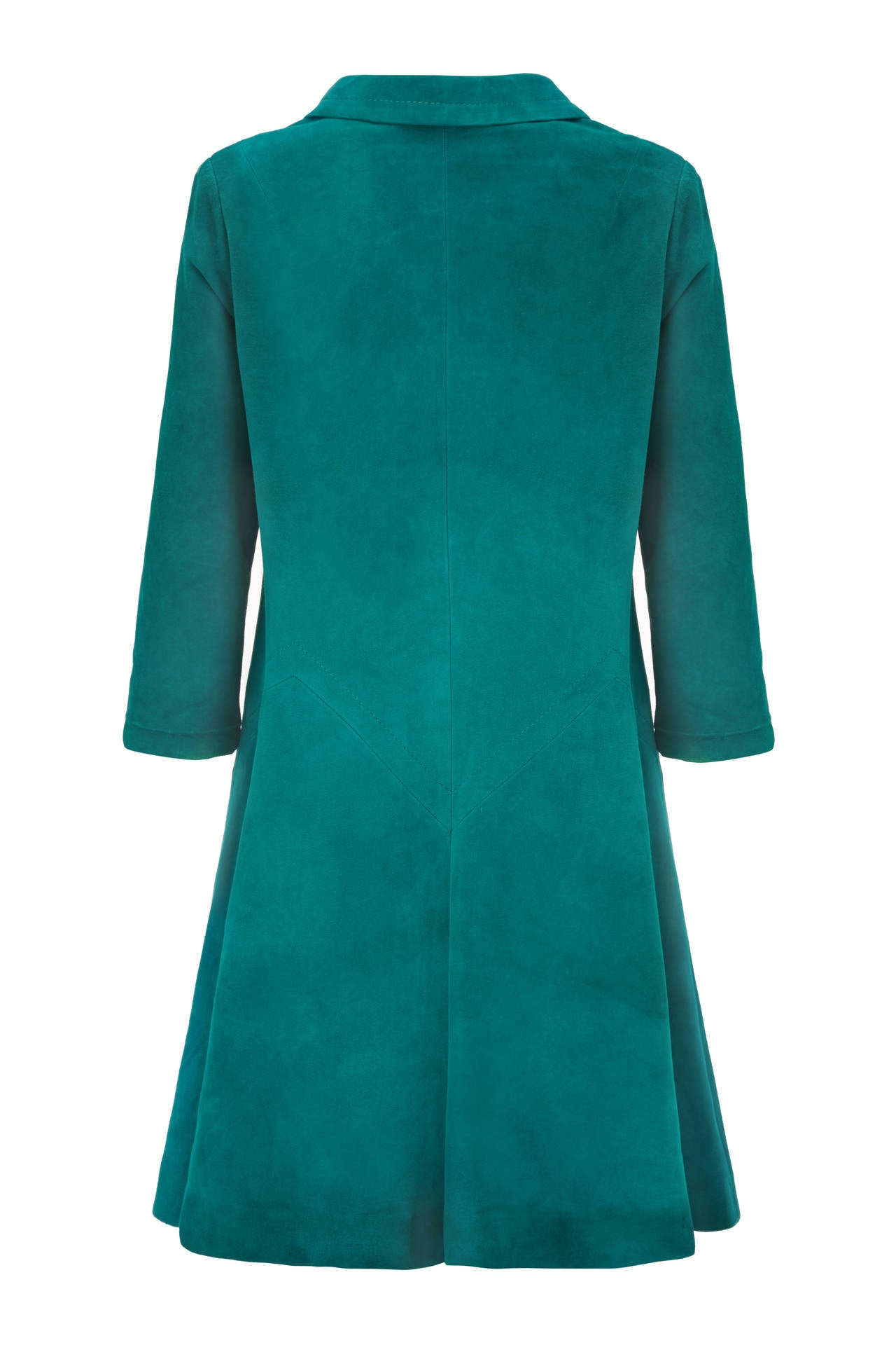 Beautiful teal suede double-breasted trapeze coat from iconic French designer Pierre Cardin.  An early piece from an important designer this beautiful coat features a zig-zag seam at hip level and large covered buttons to fasten at the front. It is
