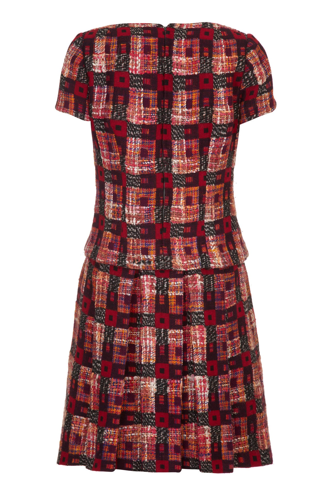 Lovely fantasy wool tweed winter dress from Harrods in tones of red, orange and brown.  This vintage dress has the appearance of a separate top and skirt but is in fact one piece with a box pleat skirt attached to the lining of the bodice. It