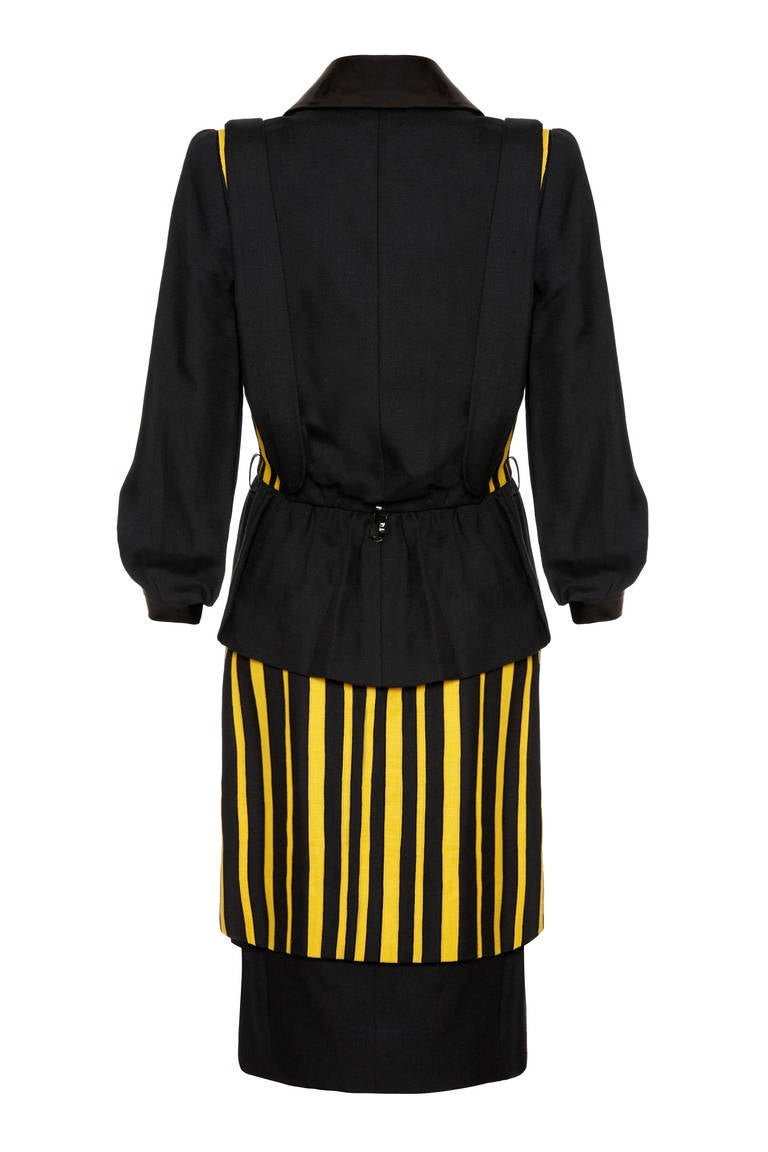 Amazing, quirky little 1980s skirt suit by Pierre Balmain.  This set consists of a gorgeous and beautifully haute couture made black linen jacket with matching double layer black and yellow striped pencil skirt. The peplum jacket features the same
