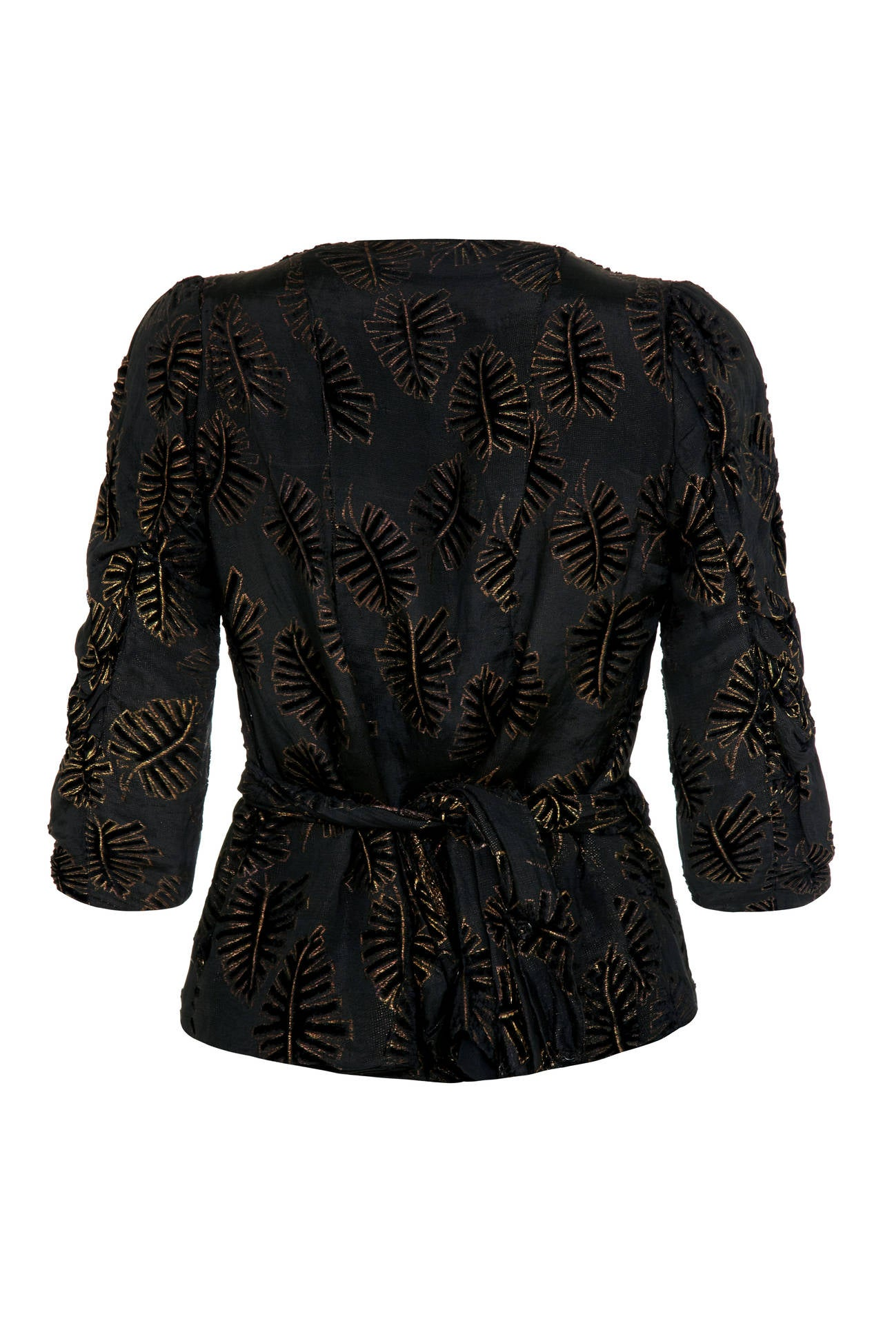 Simply stunning black and gold lame woven top with embossed black velvet leaf pattern.  This piece features ¾ sleeves and pretty matching scarf/ belt, which is attached at the shoulders of the V neckline, crosses over at the front and wraps around
