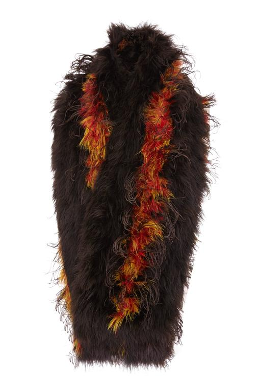 Fantastic vintage 1930s marabou feather stole in stripes of darkest brown and red, orange and yellow mix.  Rectangular in shape it is lined underneath in cotton and is in excellent condition with no noticeable flaws.