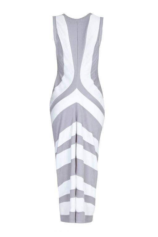 Cotton and polyester jersey dress with wide grey and white stripes and shaping at the front. There are no fastenings and the dress is in excellent condition. Labeled size Medium which is the equivalent of about a UK 12, US 8.