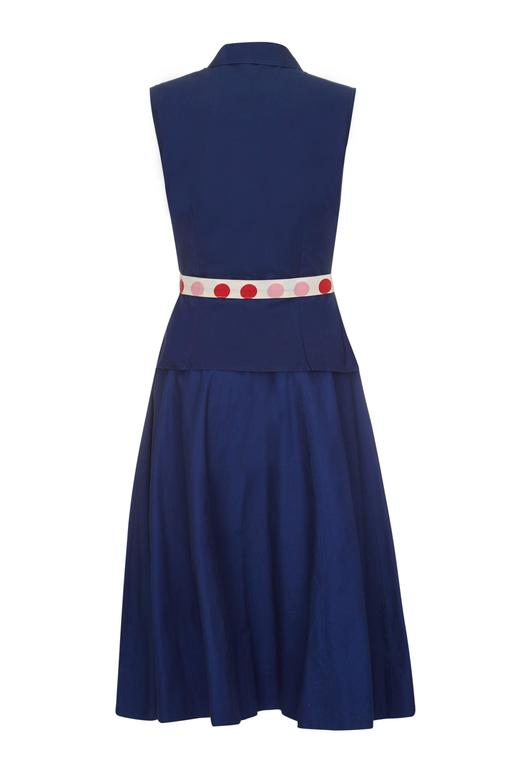 Lovely vintage set from Jonathan Logan dating from the late 1950s/ early 1960s.  This thick navy cotton sleeveless shirt and skirt set has a matching belt with polka dots coordinating with the pink, red and blue covered buttons. The skirt features