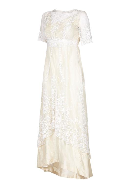 Exceptional and incredible vintage Edwardian wedding dress with amazing top layer of hand made lace featuring floral designs.  The lace looks to be Brussels and/or tambour lace applied to machine-made net and both bobbin and needle lace motifs.