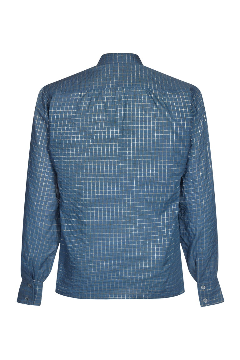 Original Yves Saint Laurent 1970s French blue and metallic gold thread checked blouse / shirt.  A high necked collar and cuffs, the shirt is a loose fit style designed to be tucked into the high waisted skirts and trousers of the era.  In superb and
