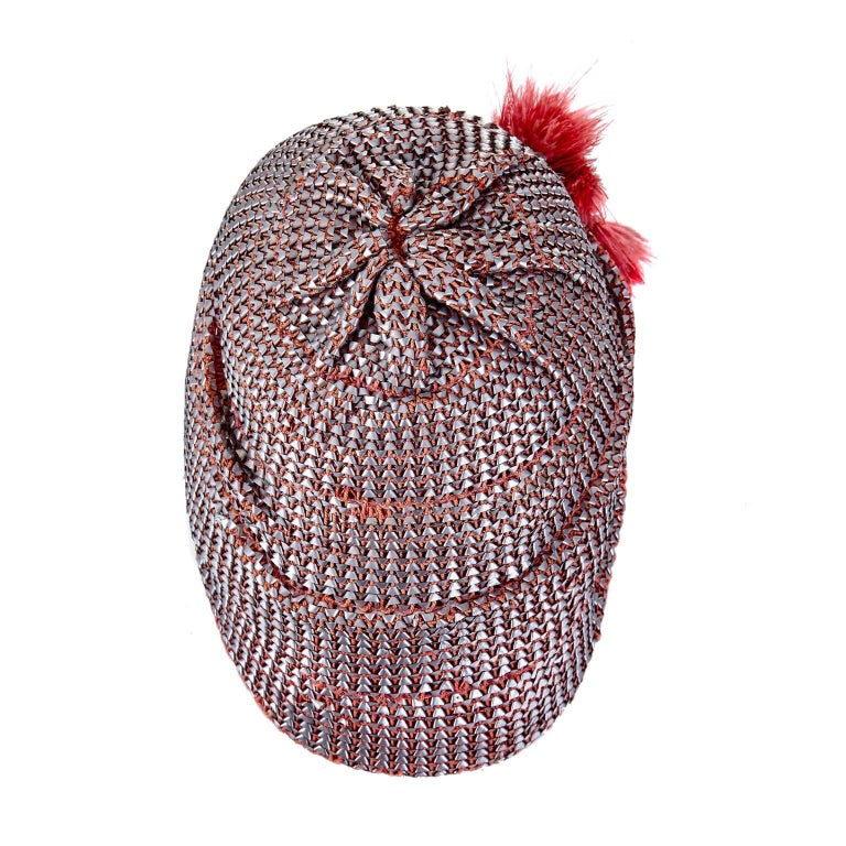 This exquisite 1920s Flapper cloche hat with metallic raffia weave is in excellent vintage condition. The hat is moulded in soft red felt, with a gross-grain band on in the interior so that the hat easily retains its position when worn. The exterior