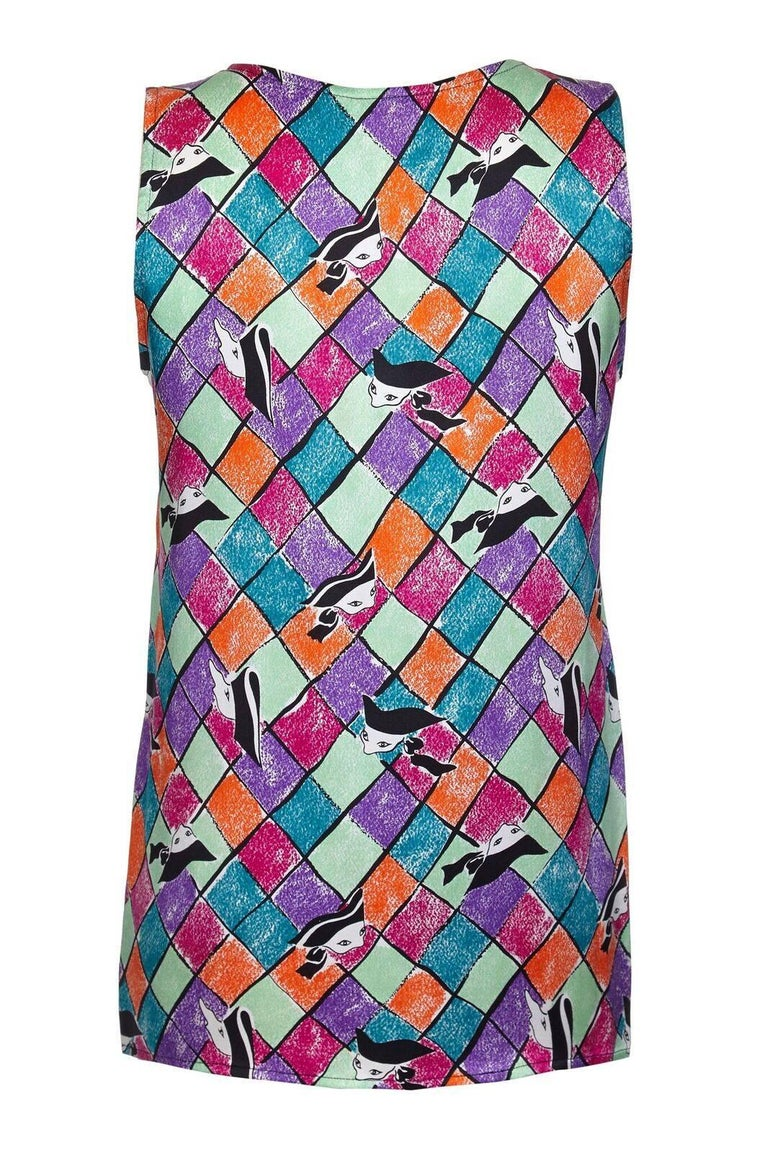 This vibrant and colourful late 1980s early 1990s Yves Saint Laurent silk top is in pristine condition and beautifully cut. The playful abstracted harlequin print in dark pink, purple, orange, mint green and turquoise give this piece a playful and