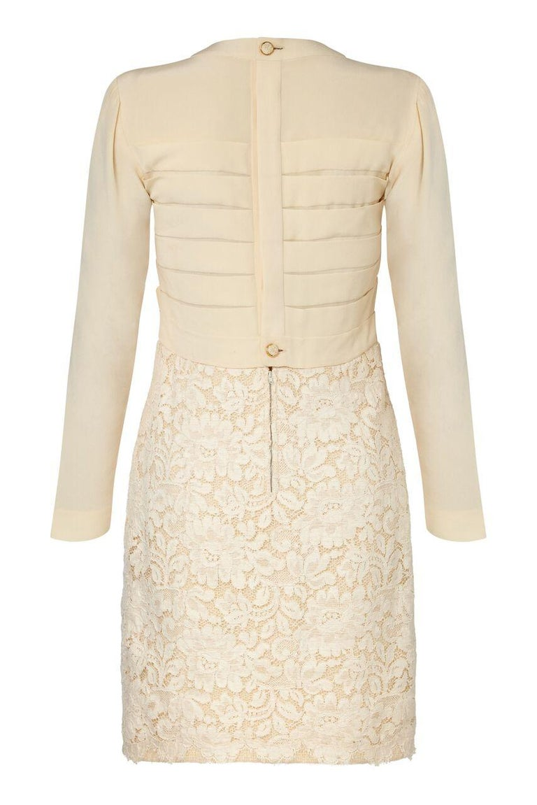 This extraordinary 1980s Chanel Haute Couture two piece set is in impeccable condition and showcases some unusual textural design features. The long thigh length jacket is made of wool fantasy tweed in ivory cream and has a beautiful lace overlay