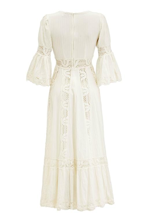 Beautifully simple full-length thick white cotton vintage 1970s Mexican wedding dress with vertical pin tucks and lace inserts and trim throughout.  There is a cross over front with fluted ¾ length sleeves and original metal zip to fasten at the