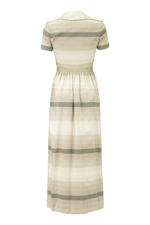 Fantastic heavy silk, long, shirt-waister dress with grey toned horizontal stripes by Oscar de la Renta.  This vintage late 1960s pret-a-porter design was an early label for the designer after he branched out on his own having designed for the