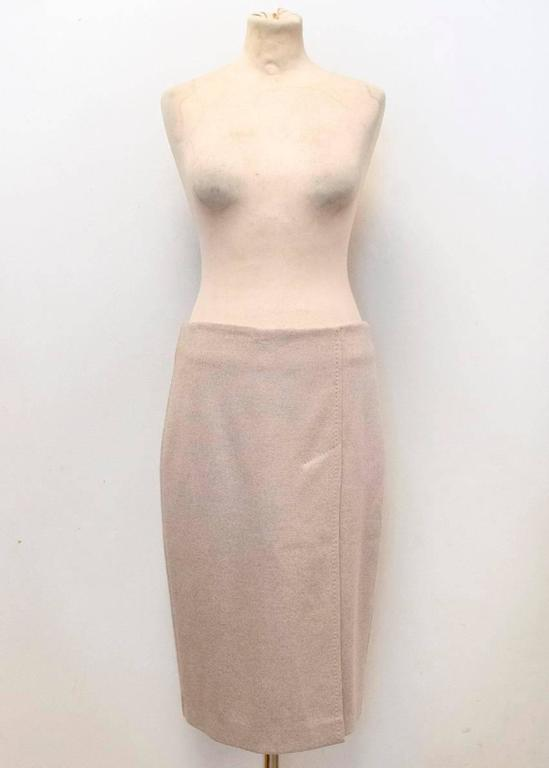 MaxMara beige pencil skirt featuring a front-side slit. The skirt is soft to the touch, slim fitting and fully lined with a concealed back zipper. 100% Virgin wool. Size 42/US 8.