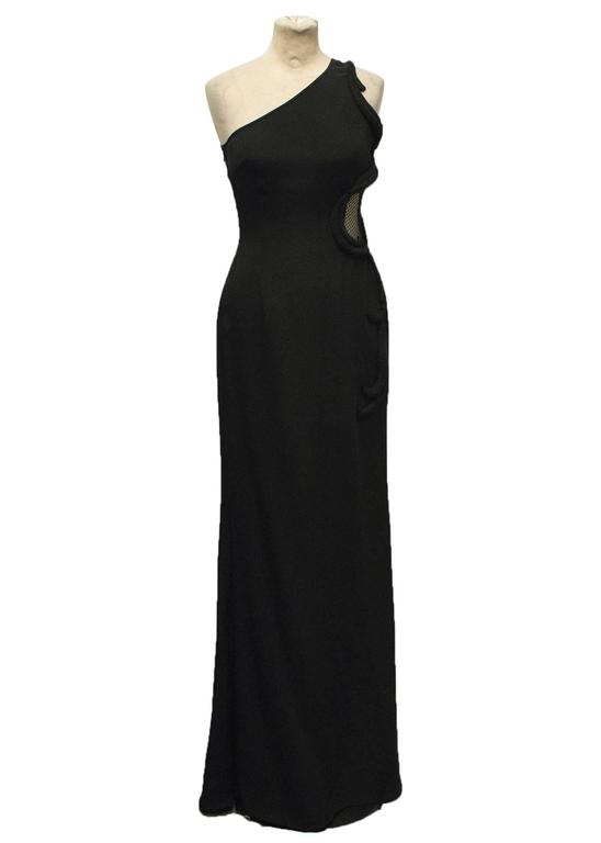 Stella McCartney black one shoulder sleeveless floor-length gown. The gown is fitted to the waist with a flowing skirt, mesh cut-out detail on the side and a rope embroidery trim to the side and shoulder. Size IT40/ US4  Made in Italy. Dry Clean