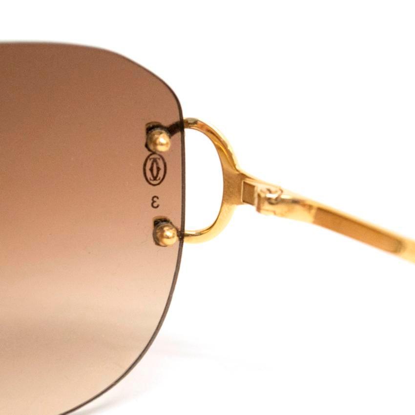 b0464da59f Cartier Rimless Sunglasses With Gold Hardware at 1stdibs