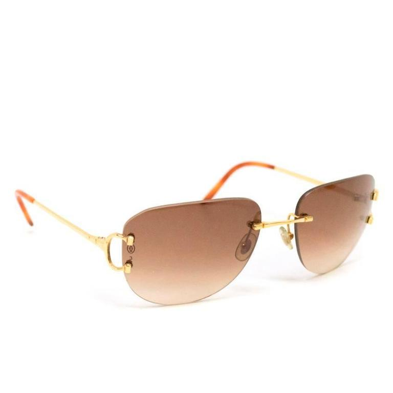 e1876d0534ab Cartier rimless sunglasses featuring brown lenses and gold hardware. Item  comes in its original box