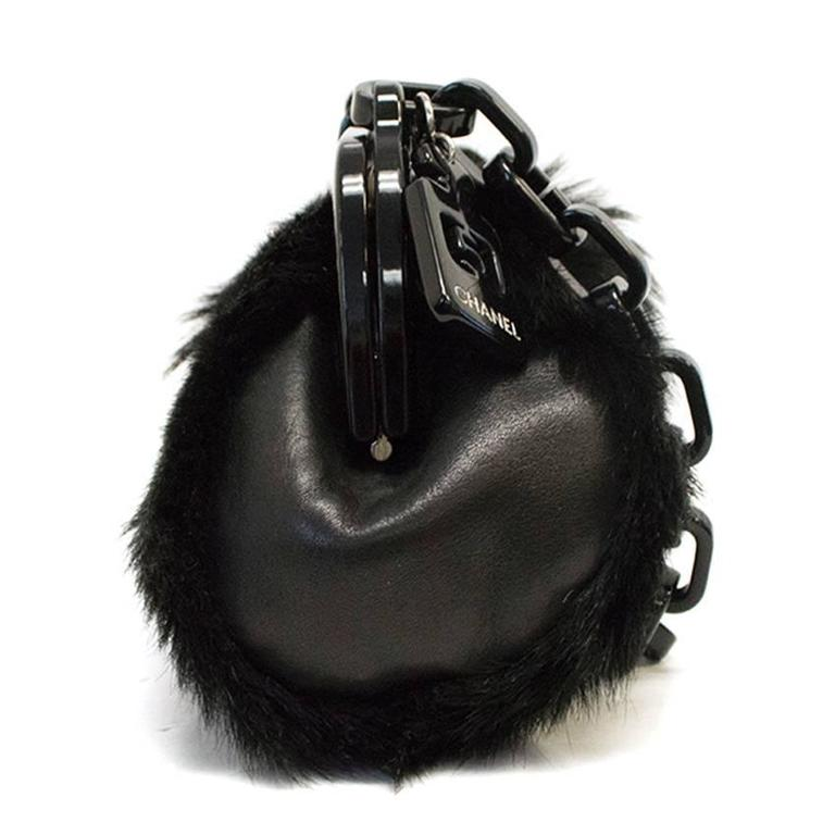 855bfb73bcbc Chanel black fur bag with plastic chain and clasp with Chanel logo. Bag is  in