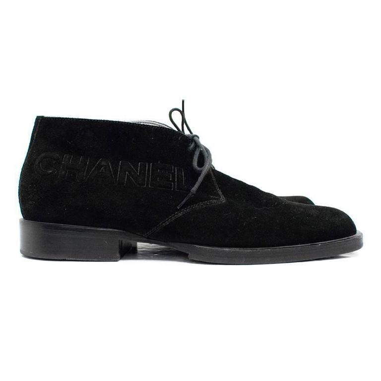 Chanel black suede lace up shoes with a square toe, slight heel and silver lining. Raised Chanel detail across the side.   Conditions Details : Condition: 9.5/10   Slight marks to the suede and soles have been re-soled.  Approx measurements: