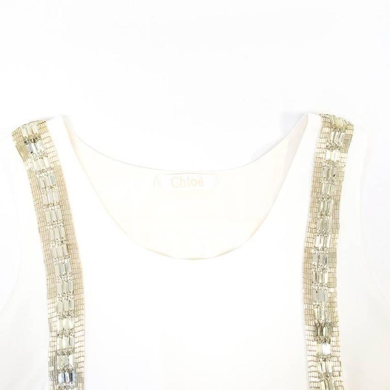 Chloe White Beaded Arrow Top. Never worn, without tags 10/10. Perfect condition. Made in France. Belongs to Caroline Stanbury from 'Ladies of London'.  Approximate measurements:   Shoulders: 33cm  Length:39.5cm  Bust: 46cm  UK size 8 US size 4