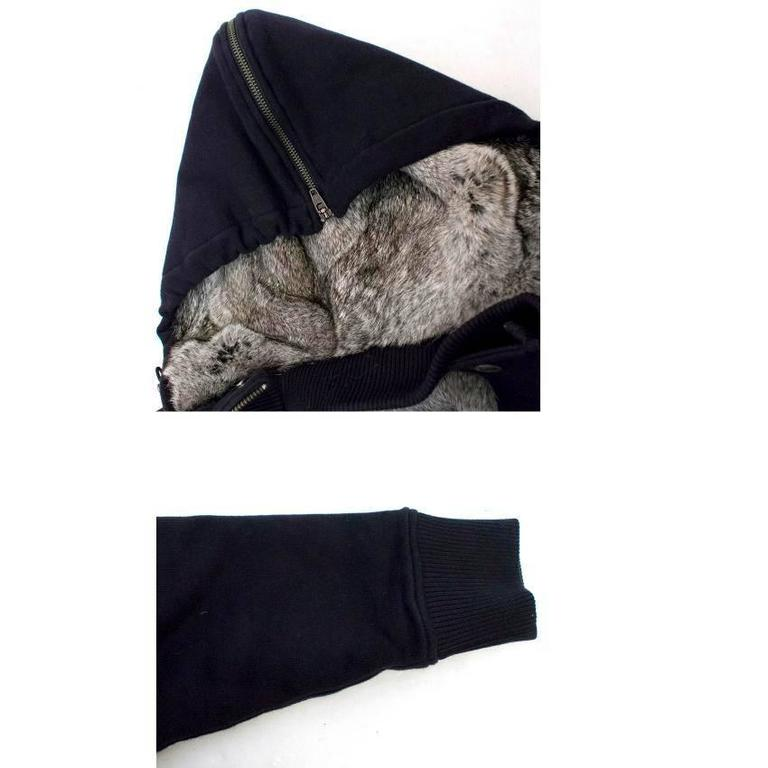 Michael Kors thick, navy, hooded sweatshirt, lined with grey rabbit fur. It features a gunmetal zip and popper front closure and two exterior, popper button down pockets.   Condition: 10/10  Size: S Size UK: 36 Size EU: 46  Measurements Approx