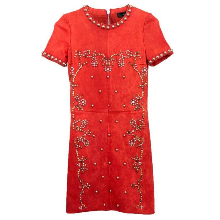 Isabel Marant red leather Bora dress with silver gold, brass and gunmetal rivots throughout and pink and gold crystal embellishment. Mini dress with crew neckline and a fitted cut.  - Dry clean only - Some stretch due to the fabric - Back zip