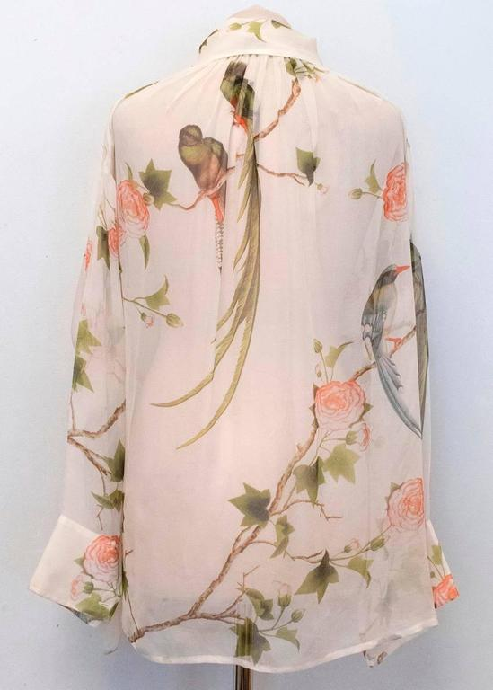 Alexander McQueen cream sheer, long sleeved blouse with pink and green floral pattern. It also features a classic collar and ruffle detailing from the neck to the bust.  Condition: 9.5/10  Size: M Size EU: 42 Size UK: 12 Size US: 8  Measurements