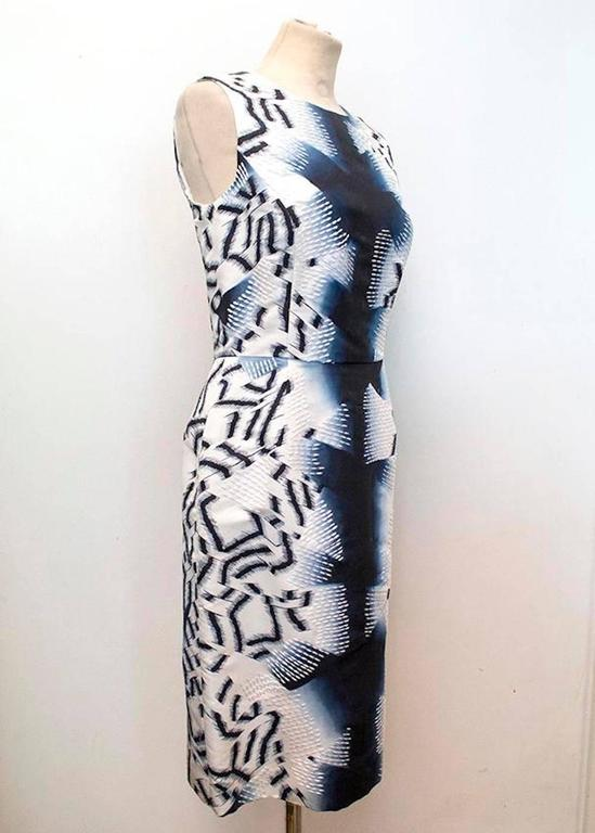 Oscar de la Renta abstract print sleeveless silk dress with white embroidery. Fitted style that is cinched at the waist with soft boat neckline.  - Made in USA - Dry clean only - Fully line with internal grosgrain ribbon waist fastening - Invisible