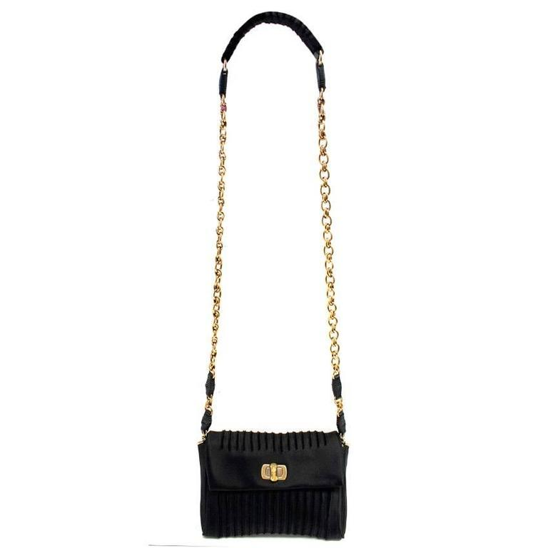 0785aa2fa48b Nina Ricci black satin small cross body bag. Features, a front flap,  textured
