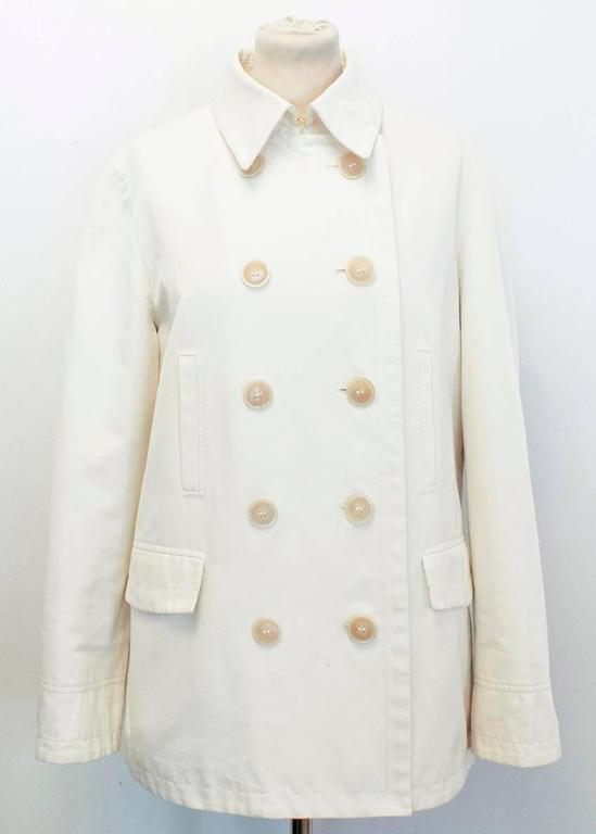 Loro Piana beige double breasted, collared coat with a single vent in the back. Features 5 pairs of buttons on the front and 4 functioning pockets.   Approx measurements. Length -77cm  Shoulders -41cm Chest -49cm  Arms -53cm   EU SIZE 48  UK SIZE 38