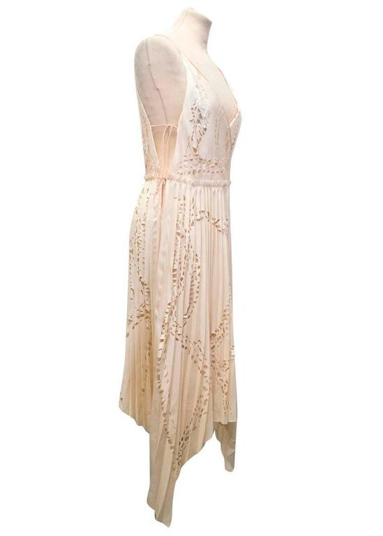 Emilio Pucci matte-satin and silk nude pleated silk dress, with laser cut detailing and ribbon shoulder straps. Loose fitting and lightweight.   Condition: 10/10  Size IT: 40 Size UK: 8 Size US: 4  Measurements