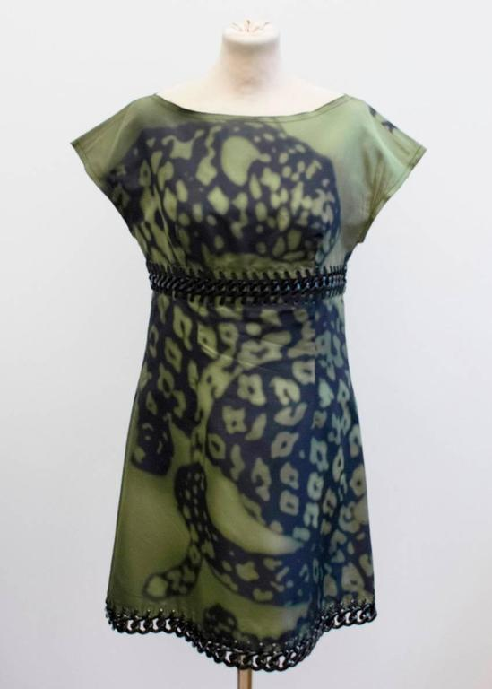 Prada green and black printed silk dress. Features lace and curb chain details at the waist and hemline, short capped sleeves and a round neckline. Fastens at the back with zipper.   Size label IT 42 US 6  Conditions Details : Condition:9.5/10