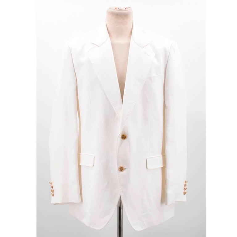 Dolce & Gabbana white jacket in a single-breasted style with notch lapels and light shoulder padding. With stitch effect on the lining of the lapels, one chest pocket and two front flap pockets.   Size: XL Measurements: Approx. Shoulder: 46cm