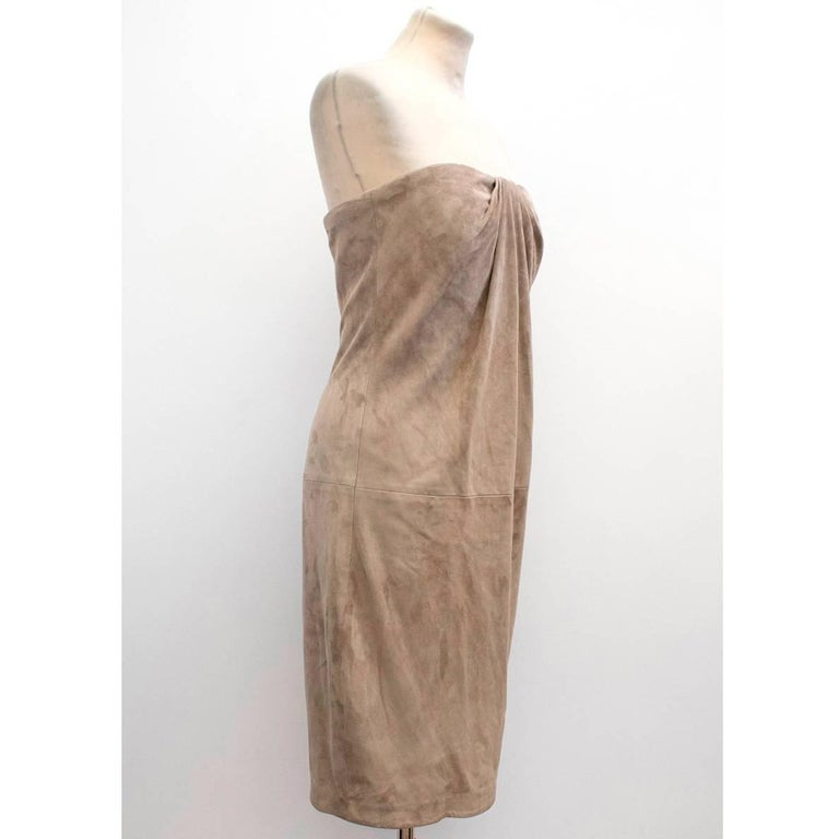 Ralph Lauren taupe suede strapless dress in a knee-length style with gathered detail at the bust. Lined with silk and fastens with a back zip.   Condition: 10/10  Measurements are taken laying flat, seam to seam.  Approx. Bust: 39 cm Waist: