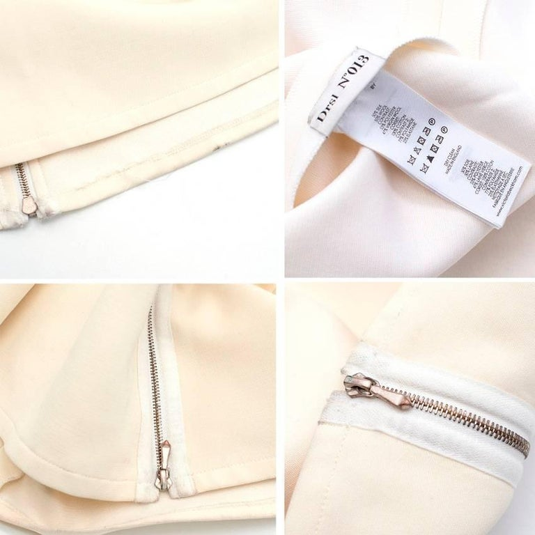 Strapless long cream gown with long silver rear zip.  Approx Measurements: Waist:39 Cm Length: 138 Cm  Fabric: 50% Silk, 50% Wool  Size	S Label Details	UK10/US 6.   Conditions Details : Condition:9/10, very minor marks to the dress that is not