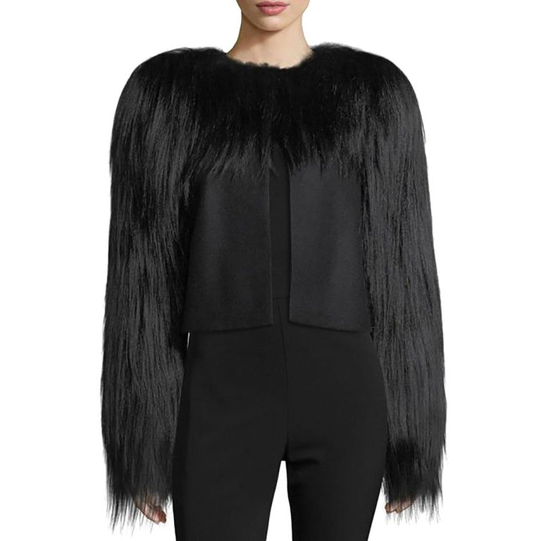 Bottega Veneta Fur-Trim Wool Jacket  - Wool jacket with dyed goat hair fur trim around neckline and covering sleeves - Round neckline and semi-open front - Long sleeves - Strong shoulders - Boxy silhouette  Sizing: Italian size 36 US