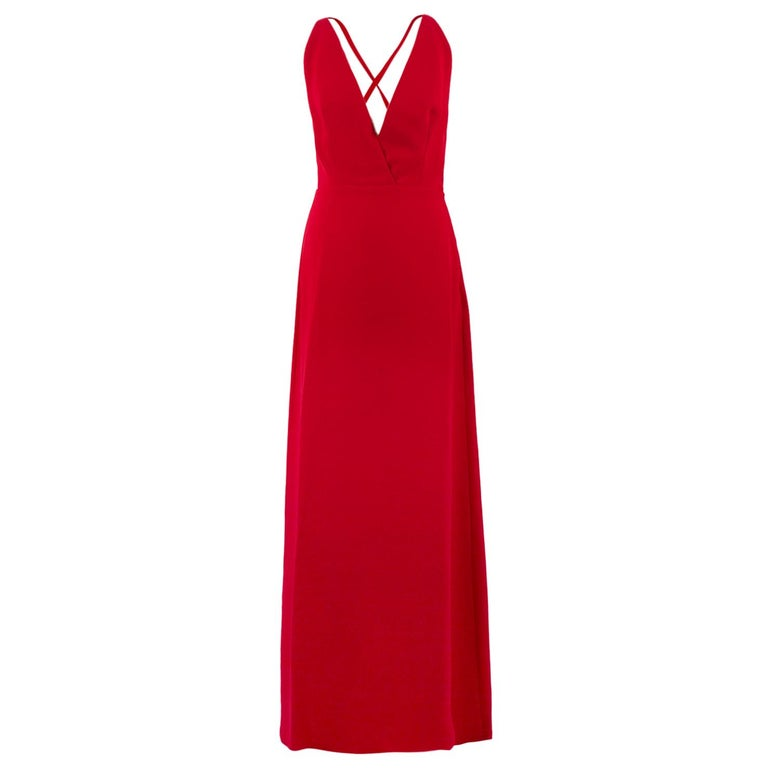 Valentino Red Silk V-Neck Gown  -100% silk -V neck  -Cross over ribbon straps -Concealed side zip closure -Tailored around the bust and waist  Sizing: US size 4 Italian 40 XS  Approx. Length - 148cm Waist - 32cm  Condition: 9.5/10 Great condition,